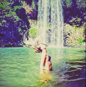 hair flick at millaa millaa falls, atherton tablelands